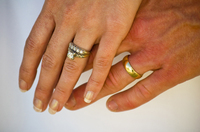 http://aaronstern.typepad.com/aaron_sterns_blog/images/2008/06/29/wedding_rings_by_garrisonphotoorg.jpg